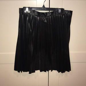 Never worn Black pleated leather mini skirt
